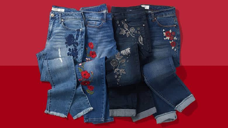 4 pairs of jeans with embroidery embellishments on red background